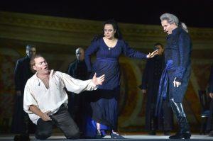 Police chief Scarpia (r), Tosca, and her tortured lover, Cavaradossi, in Puccini's 'Tosca'--at Masada. (Yossi Zwecker)