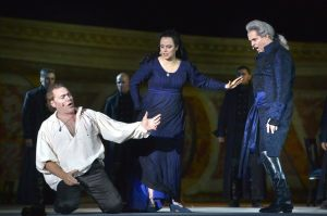 Police chief Scarpia (r), Tosca, and her tortured lover, Cavaradossi, in Puccini's 'Tosca'--at Masada. (Yossi Zwecker)
